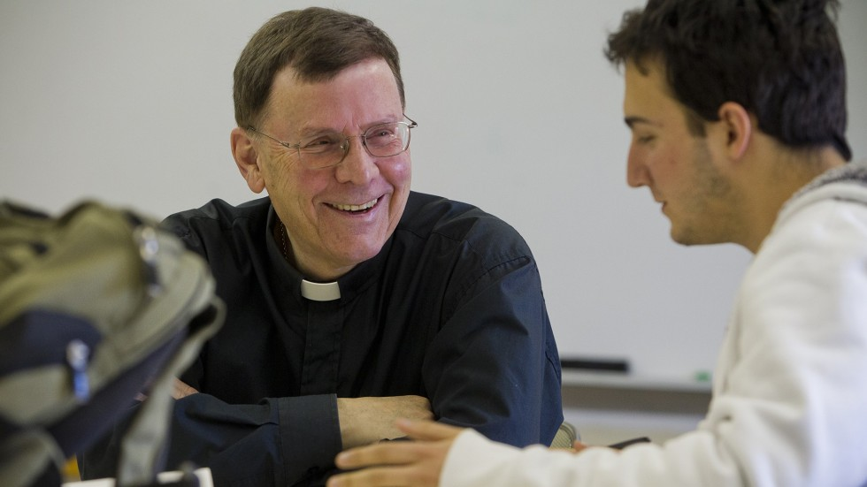 Photo of Rev. Chichetto with student