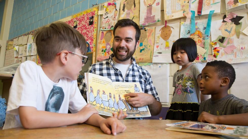 Teacher reads students a book