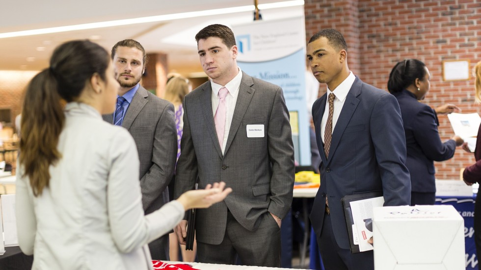 Career Day photo of students meeting with businesses