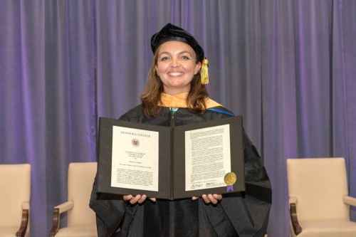 Professor Lombardi holds the Hegarty Award.